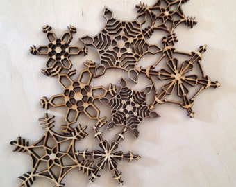 Eight Rustic snowflake ornaments 2 inches to 3 inches in size.