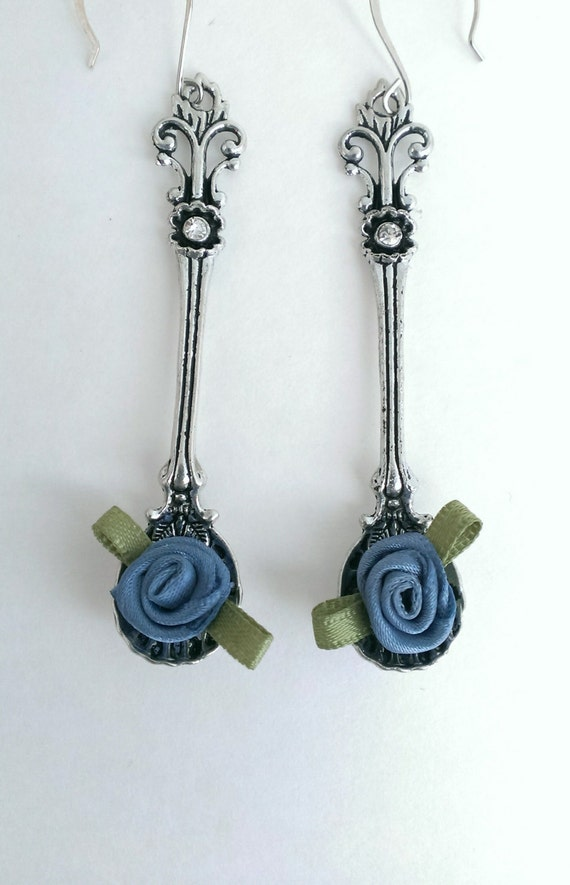 silver toned spoon earrings with blue satin flowers whimsical