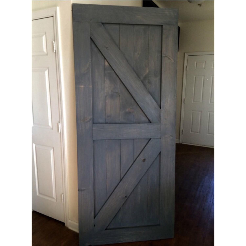 Custom made sliding barn door british brace by for Custom sliding doors