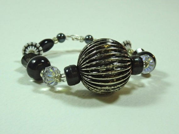 Silver-color metal /black beaded bracelet
