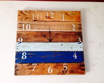 Pallet Clock made from reclaimed pallet wood and painted stenciled numbers.