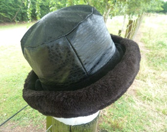 Black  vintage hat with faux fur trim. Hat is a synthetic viscose on the top bit. Looks stunning. Will merge superbly with any winter otfit.