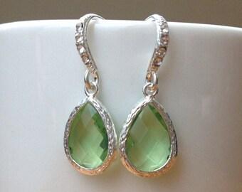 Silver and light green framed crystal earrings