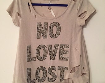 "Beige ""No Love Lost"" soft tee in Medium."