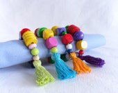 Set of 4 napkin rings, mix of colorful wooden beats with tassel from Join us for Dinner