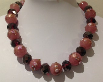 Necklace. 44cm. Features Large round Lampwork Glass beads.Pink/red. Crystal faceted beads