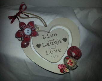 Wooden wall plaque with paper flowers