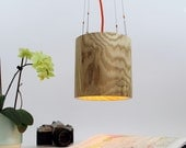 Wooden hanging light with orange round silk cable. Solid ash.