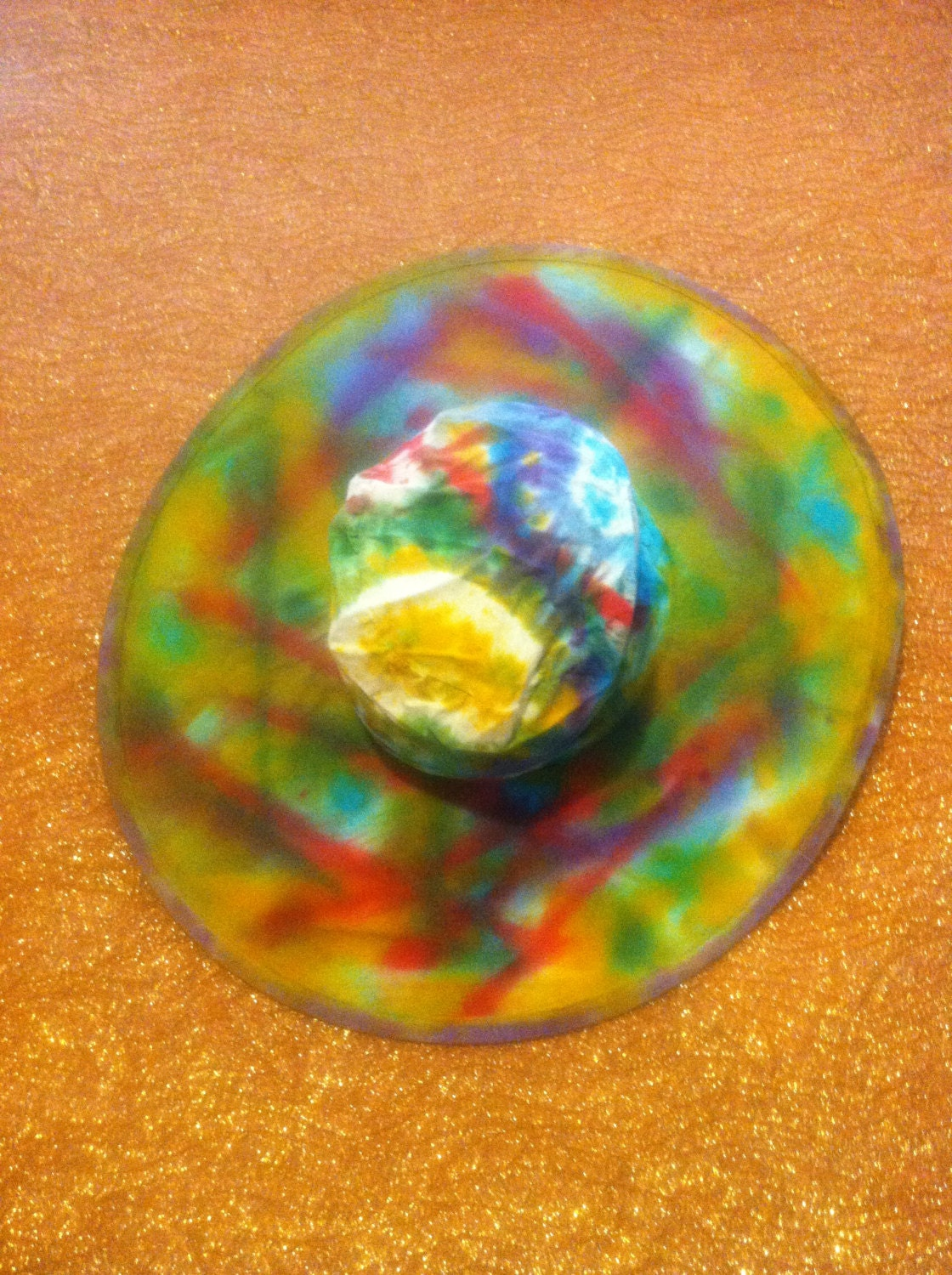 custom tie dye or painted sun hat folds into matching