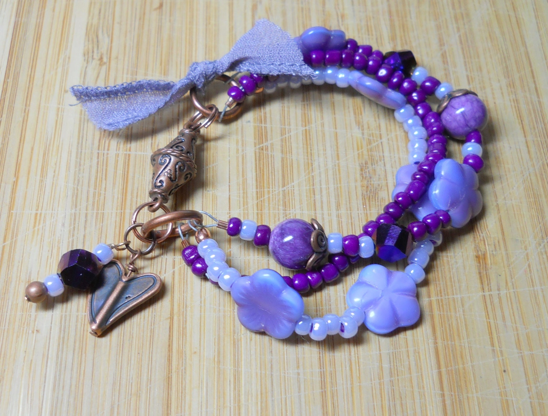 purple beaded bracelet artisan jewelry handmade by