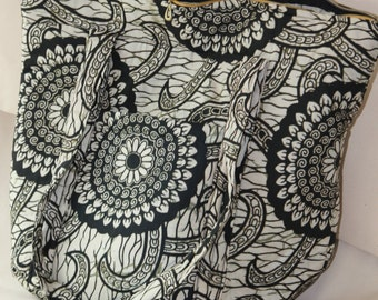 Spacious hand stitched African print bag with one outer pocket six inner pockets and cotton padding for additional comfort