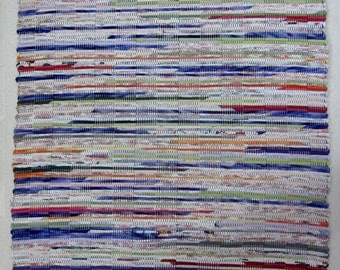 colorful handwoven rag rug made from recycled t-shirts