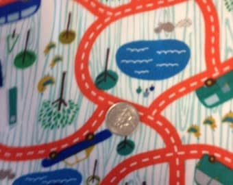 Flannel with roads,cars trees in colors of orange green, blue.  off white background and a Riley Blake cotton fabric