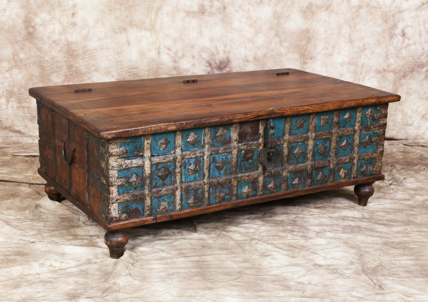 Antique blue cream indian trunk coffee table metal latch storage metal accent bands haute juice Old trunks as coffee tables
