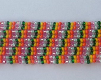 Bracelet with beads of various colors made completely by hand