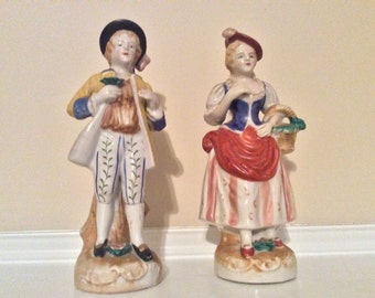 Woman and Man Colonial Porcelain figurines, Occupied Japan.
