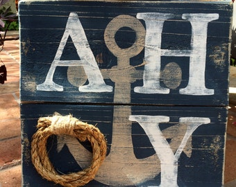 "Wood ""Ahoy!"" sign with jute rope"