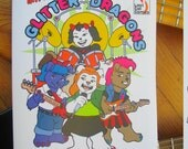Meet the coolest all-girl puppy rock band! Introducing The Glitter Dragons! A new and original coloring book
