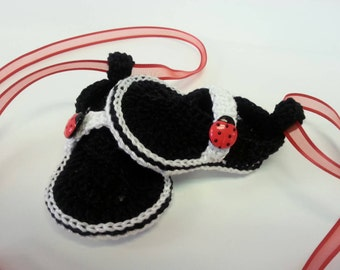 Adorable black and white crochet thong sandals with ladybugs and ribbons.