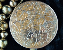A superb German silver compact decorated with grapes and vine leaves. A fabulous addition to any compact collection.