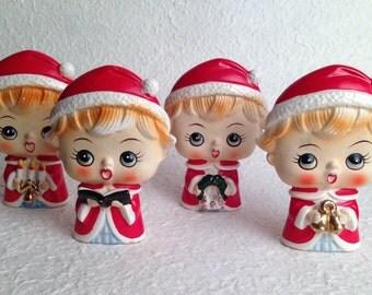 A set of 4 Mid-Century Christmas Caroler Figurines