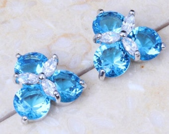 Blue and white topaz sterling silver stud earrings