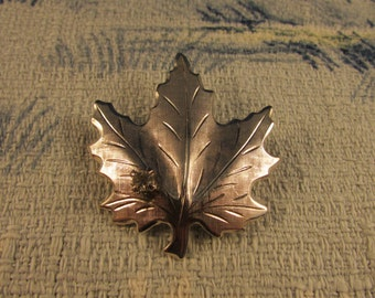 Vintage brushed silver-tone maple leaf with diamanté detail