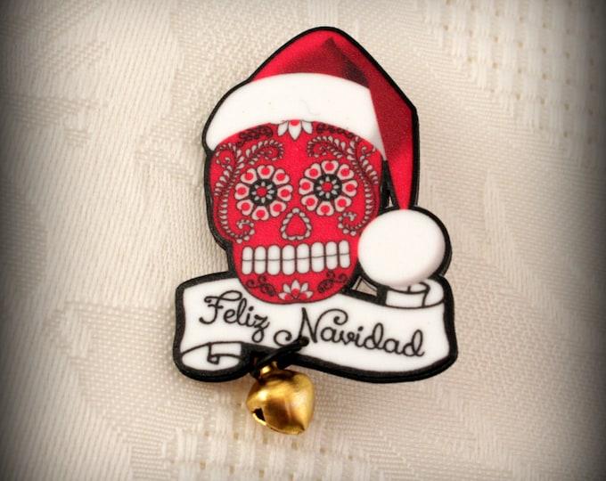 Feliz Navidad Pin - Merry Christmas Pin - Sugar Skull Santa Hat - Gold Jingle Bell - Pin Brooch in Bright Red - Santa Hat Pin - Plastic