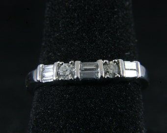 Round Brilliant and Baguette Cut Diamond Band