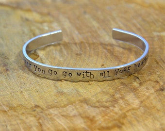 Hand stamped cuff bracelet 'Wherever you go, go with all your heart'