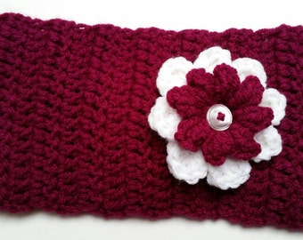 Size Adult. Maroon head band with maroon and white flower attached in the back with button.