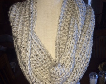 Cream colored chunky crocheted infinity scarf.
