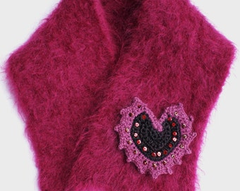 A rich and sumptuous knitted stole made from brushed mohair, with crocheted and beaded heart