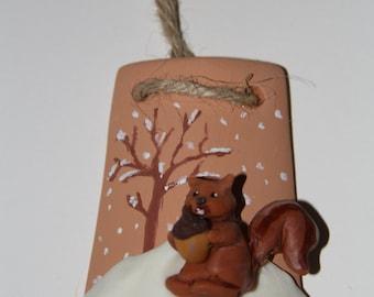Decorative terracotta shingle representing a squirrel