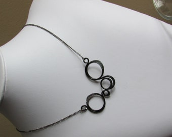 Aluminium hammered necklace on black chain