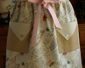 Half apron with two pockets and vintage detal