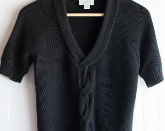 A Black Short Sleeved Sweater