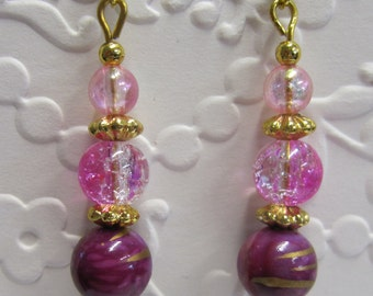 Pink and Purple romantic drop earrings with gold fittings.
