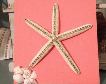 Salmon pink colored plaque with green bedazzled starfish and shells/ wall hanging / bathrooom / kids room/ bedroom / beach theme