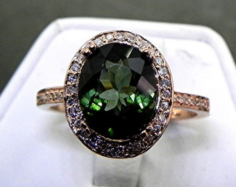 AAA Green Tourmaline   10x8mm  2.62 Carats   in a 14k ROSE gold ring with diamonds (.32ct) Ring 1138 MMM