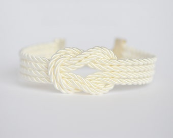 Ivory cream forever knot nautical rope bracelet with silver anchor charm