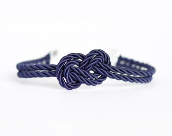 Navy blue infinity knot nautical rope bracelet with silver anchor charm