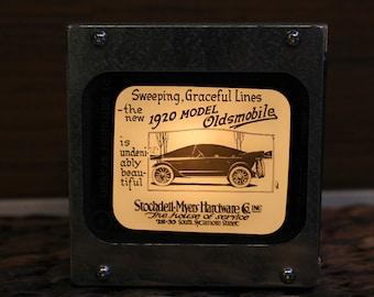 OLDSMOBILE AD #5- Vintage magic lantern glass slide light box