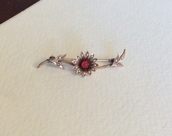 Beautiful 14k rose gold flower brooch with seed pearls and gem