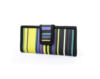 Two fold Wallet. Water resistant. Stripes in green, black, purple, teal. 6 card slots, 2 wide slots, 2 zipper pockets.