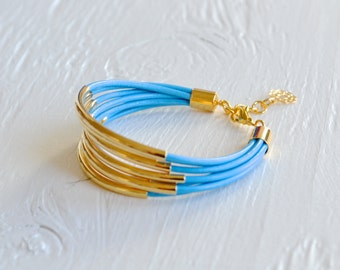CLEARANCE  SALE : Sky Blue Leather Cuff Bracelet with Gold Tubes ... DISCONTINUED