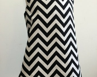 Black and white chevron print A line dress with orange piping