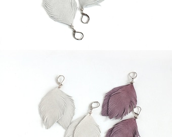 Suede leather feather earrings in smoky violet and in light grey. Set of two