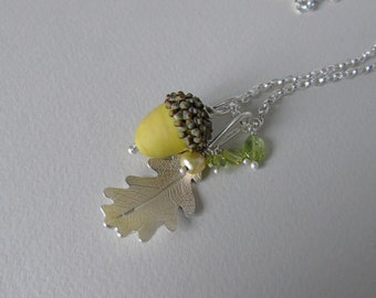 Silver oak leaf and green glass acorn necklace