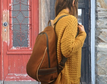 Minimal  backpack in heavy cotton canvas, copper color with leather details,named Daniella